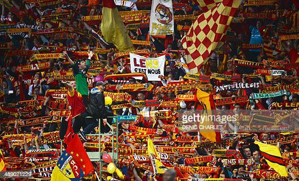 Lens' supporters show their team scarves during the French L2 football match between Lens and Brest at Felix Bollaert stadium in Lens on May 9 2014...
