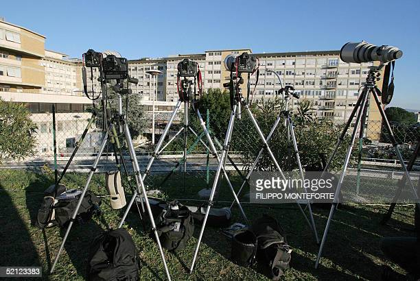 Lenses are pointed at the windows of the Policlinico Gemelli hospital in Rome 02 February 2005 Pope John Paul II was said to be in a stable condition...