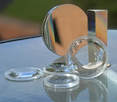 An assortment of various lenses, mirrors, and prisms