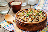 Lentils and rice with Crispy Onions and Parsley. Mujadara. toning. selective focus