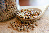 Lentils legumes beans with wooden spoon