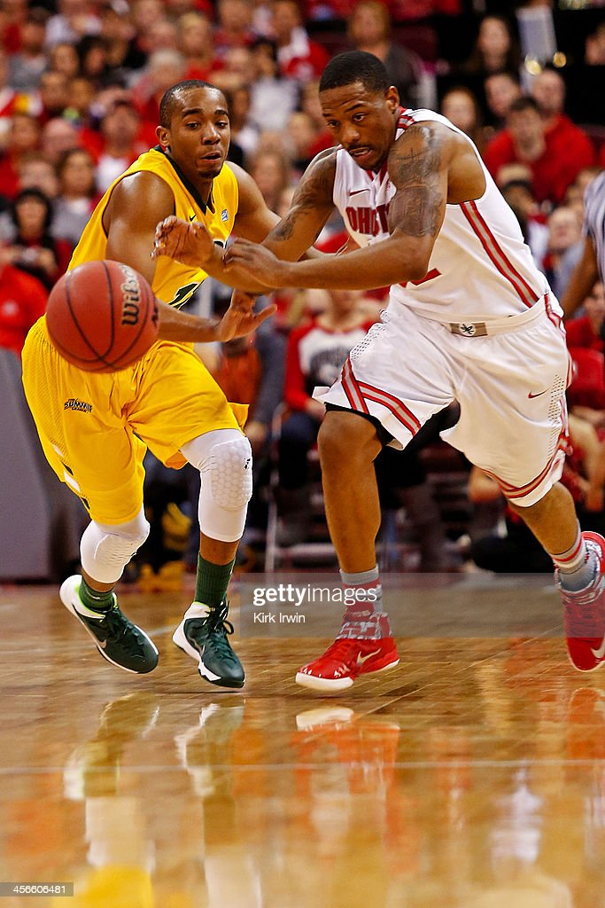 Lenzelle Smith, Jr. #32 of the Ohio State Buckeyes and Lawrence Alexander #12 of the North Dakota State Bison chase after the loose ball during the first half at Value City Arena on December 14, 2013 in Columbus, Ohio. Ohio State defeated North Dakota State 79-62.