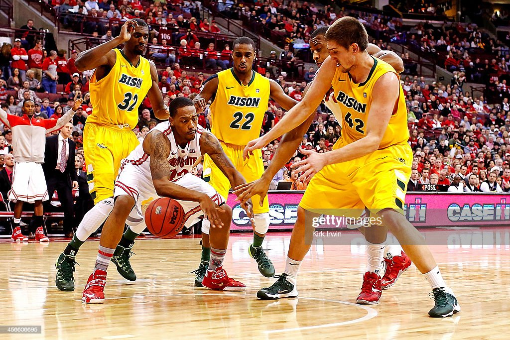 Lenzelle Smith, Jr. #32 of the Ohio State Buckeyes attempts to keep the ball from Marshall Bjorklundj #42, Kory Brown #22, and TrayVonn Wright #32, all of the North Dakota State Bison during the second half at Value City Arena on December 14, 2013 in Columbus, Ohio. Ohio State defeated North Dakota State 79-62.