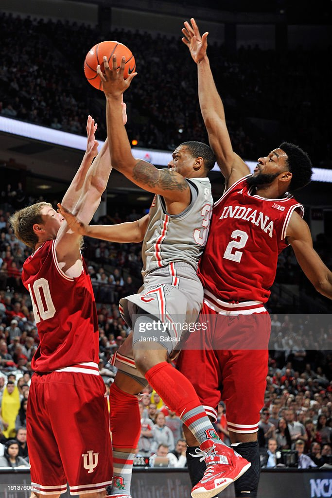 Lenzelle Smith, Jr. #32 of the Ohio State Buckeyes drives between the defense of Cody Zeller #40 of the Indiana Hoosiers and Christian Watford #2 of the Indiana Hoosiers in the second half to score on February 10, 2013 at Value City Arena in Columbus, Ohio. Indiana defeated Ohio State 81-68.