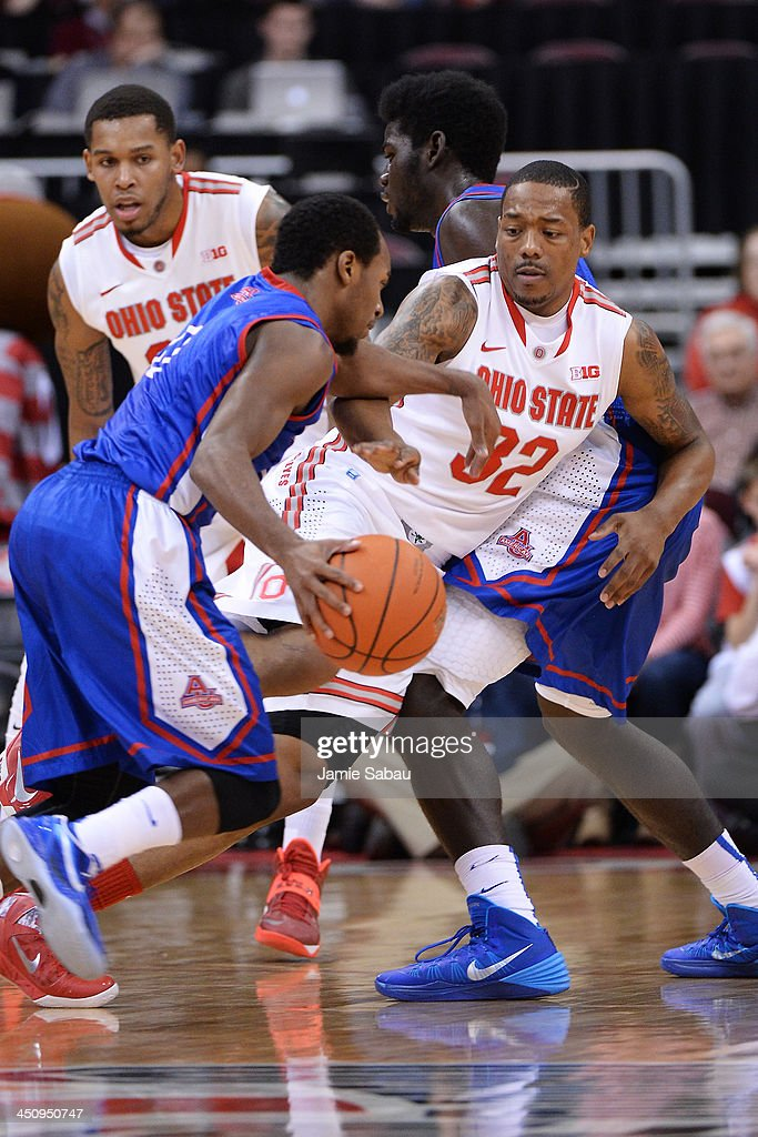 Lenzelle Smith, Jr. #32 of the Ohio State Buckeyes fights through a pick in the first half to maintain defense on Darius Gardner #0 of the American University Eagles on November 20, 2013 at Value City Arena in Columbus, Ohio. Ohio State defeated American 63-52.