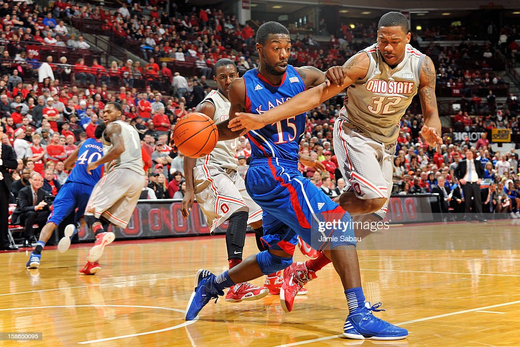 Lenzelle Smith, Jr. #32 of the Ohio State Buckeyes fouls Elijah Johnson #15 of the Kansas Jayhawks while defending him in the second half on December 22, 2012 at Value City Arena in Columbus, Ohio. Kansas defeated Ohio State 74-66.