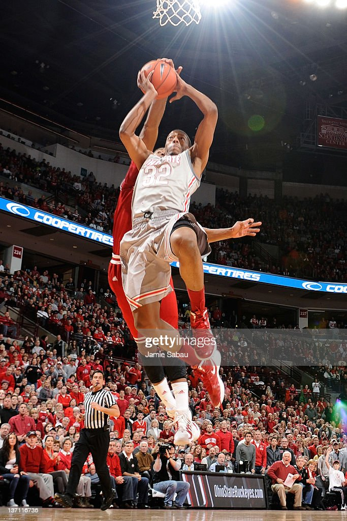 Lenzelle Smith Jr #32 of the Ohio State Buckeyes goes in for a shot but is blocked from behind by Christian Watford of the Indiana Hoosiers in the...