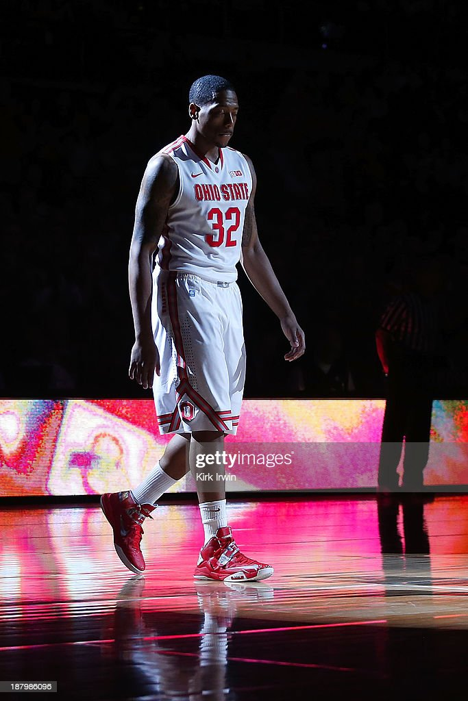 Lenzelle Smith, Jr. #32 of the Ohio State Buckeyes is spotlit during the starting line up announcements prior to the start of the game against the Morgan State Bears at Value City Arena on November 9, 2013 in Columbus, Ohio.