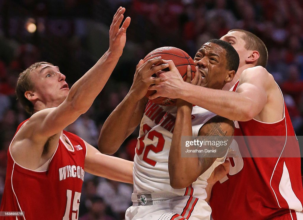 Lenzelle Smith Jr. #32 of the Ohio State Buckeyes receieves pressure from Sam Dekker #15 and Jared Berggren #40 of the Wisconsin Badgers during the Big Ten Basketball Tournament Championship game at United Center on March 17, 2013 in Chicago, Illinois. Ohio State defeats Wisconsin 50-43.