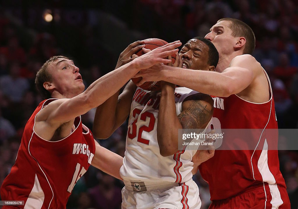 Lenzelle Smith Jr. #32 of the Ohio State Buckeyes receieves pressure from Sam Dekker #15 and Jared Berggren #40 of the Wisconsin Badgers during the Big Ten Basketball Tournament Championship game at United Center on March 17, 2013 in Chicago, Illinois. Ohio State defeated Wisconsin 50-43.