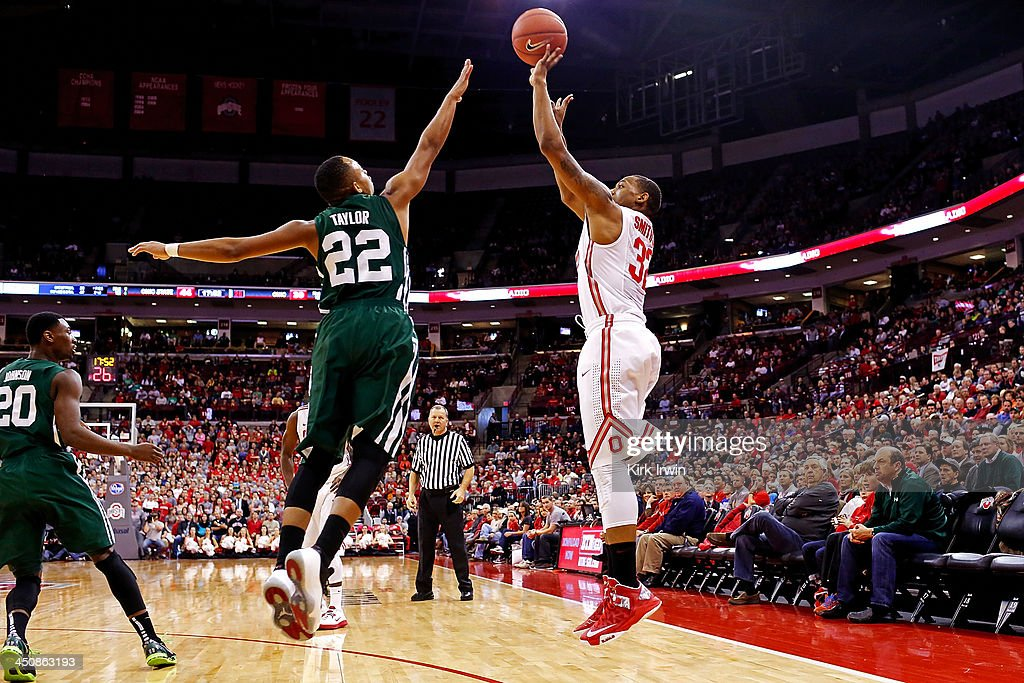 Lenzelle Smith, Jr. #32 of the Ohio State Buckeyes shoots the ball over Stevie Taylor #22 of the Ohio Bobcats during the second half at Value City Arena on November 12, 2013 in Columbus, Ohio. Ohio State defeated Ohio 79-69.