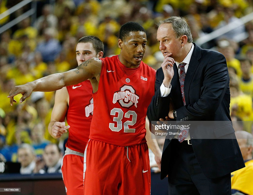 Lenzelle Smith, Jr. #32 of the Ohio State Buckeyes talks with head coach <a gi-track='captionPersonalityLinkClicked' href=/galleries/search?phrase=Thad+Matta&family=editorial&specificpeople=799910 ng-click='$event.stopPropagation()'>Thad Matta</a> while playing the Michigan Wolverines at Crisler Center on February 5, 2013 in Ann Arbor, Michigan. Michigan won the game 76-74 in overtime.