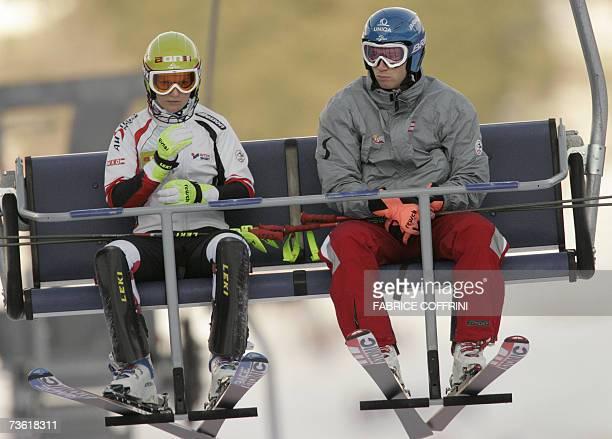 Austrian Marlies Schild and Austrian Benjamin Raich sit on a chair lift before their races at the Alpine Ski World Cup finals in Lenzerheide 17 March...