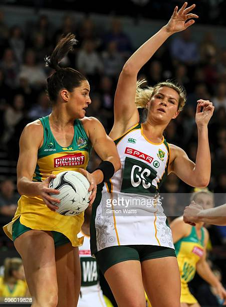 Lenzie Potgieter of South Africa and Sharni Layton of Australia compete for the ball during the International Test Match between Australia and South...