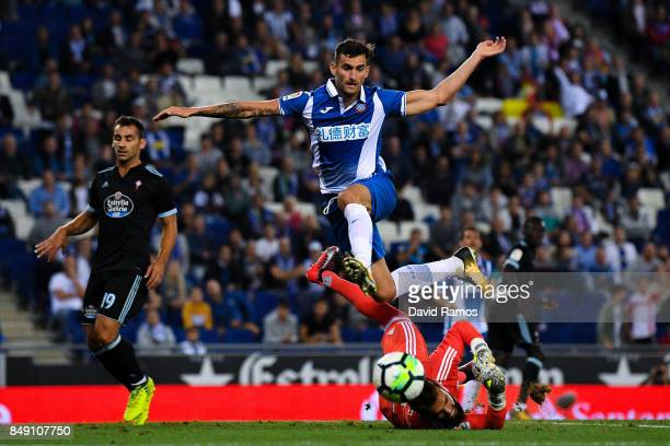 Leo Baptistao of RCD Espanyol competes for the ball with Sergio Alvarez of RC Celta de Vigo during the La Liga match between Espanyol and Celta de...
