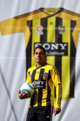 Leo Bertos models the new longsleeved Wellington Phoenix shirt during the launch of the new Wellington Phoenix kit on August 10 2011 at Midland Park...
