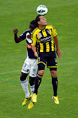 Leo Bertos of the Phoenix and Jason Geria of the Victory compete for a header during the round 27 ALeague match between the Wellington Phoenix the...