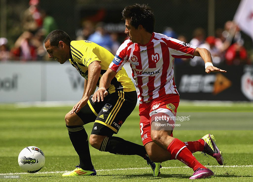 Leo Bertos of the Phoenix and Jonatan Germano of the Heart contest the ball during the round nine A-League match between the Melbourne Heart and the Wellington Phoenix at Latrobe City Sports & Entertainment Complex on December 4, 2011 in Melbourne, Australia.