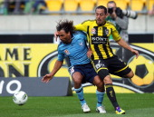 Leo Bertos of the Phoenix competes for the ball with Nick Carle of Sydney during the round eight ALeague match between the Wellington Phoenix and...