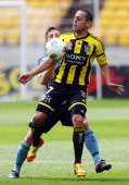 Leo Bertos of the Phoenix controls the ball under pressure from Shannon Cole of Sydney FC during the round 13 midweek ALeague match between...