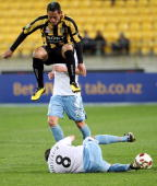 Leo Bertos of the Phoenix jumps clear of the tackle from Stuart Musialik of Sydney during the round six ALeague match between the Wellington Phoenix...
