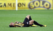 Leo Bertos of the Phoenix lies on the ground injured after a heavy challenge during the round six ALeague match between the Wellington Phoenix and...