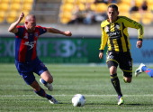 Leo Bertos of the Phoenix runs the ball past Kasey Wehrman of the Jets during the round two ALeague match between Wellington Phoenix and Newcastle...