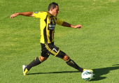 Leo Bertos of the Wellington Phoenix looks to pass the ball during the round 25 ALeague match between the Perth Glory and the Wellington Phoenix at...