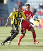 Leo Bertos of Wellington competes with Iain Ramsay of Adelaide during the round four ALeague match between Adelaide United and the Wellington Phoenix...