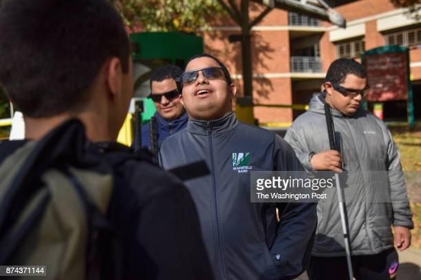 Leo Cantos 2nd from L Steven Cantos C and Nick Cantos 18yearold blind triplets chat with GMU student Wesley Littleton L after the triplets toured the...
