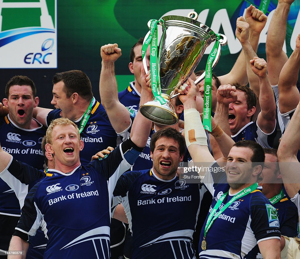 Leo Cullen (L) and Shane Jennings (R) lift the trophy in celebration with Leinster team mates following their victory during the Heineken Cup Final between Leinster and Ulster at Twickenham Stadium on May 19, 2012 in London, United Kingdom.
