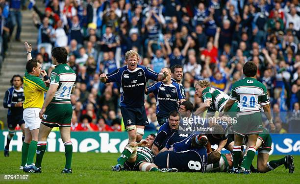 Leo Cullen of Leinster celebrates as Referee Nigel Owens blows the final whistle at the end of the Heineken Cup Final match between Leicester Tigers...
