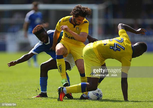 Leo Da Silva Lopes of Peterborough United in action with Alex Purver and Hadi Sacko of Leeds United during the PreSeason Friendly match between...