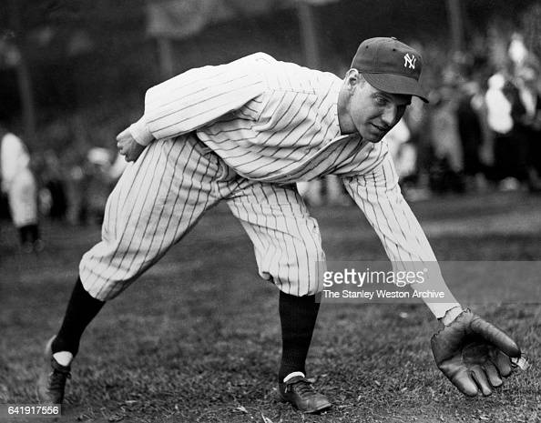 Leo Durocher shortstop and second basemen of the New York Yankees scooping up a ground ball while warming up before a game circa 1928