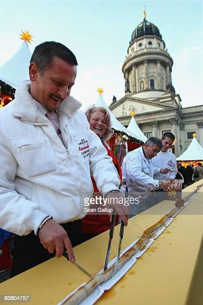Leo Friedrich head of Maximilian meat specialties and an assistant prepare what he claims is the world's longest currywurst at the Gendarmenmarkt...