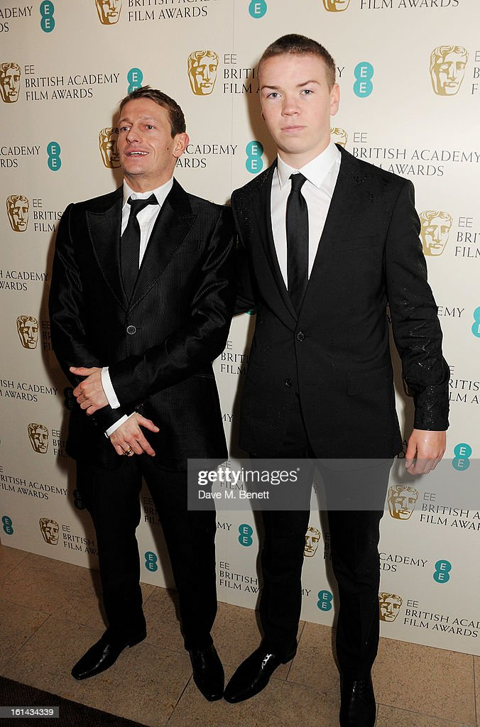 Leo Gregory (L) and Will Poulter arrive at the EE British Academy Film Awards at the Royal Opera House on February 10, 2013 in London, England.