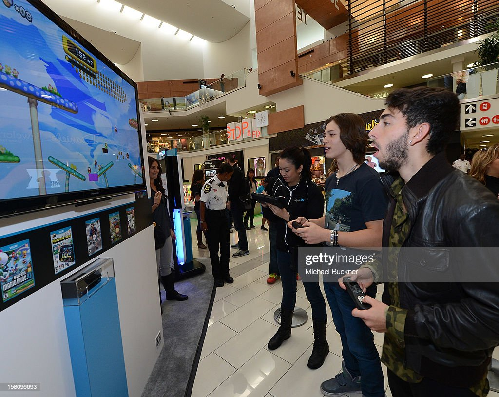 Leo Howard (L) and Mateo Arias stars of Disney XD's hit series 'Kickin' It' gets ready to battle in the Wii U Showdown at Westfield Century City Mall in Los Angeles on December 9, 2012. Wii U is one of Nintendo's hottest items of the holiday season.