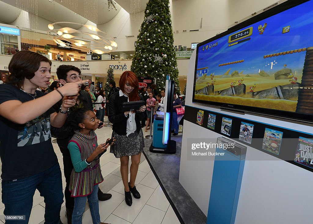 Leo Howard, Skai Jackson, Mateo Arias and Debby Ryan stars of Disney XD's hit series 'Kickin' It' gets ready to battle in the Wii U Showdown at Westfield Century City Mall in Los Angeles on December 9, 2012. Wii U is one of Nintendo's hottest items of the holiday season.