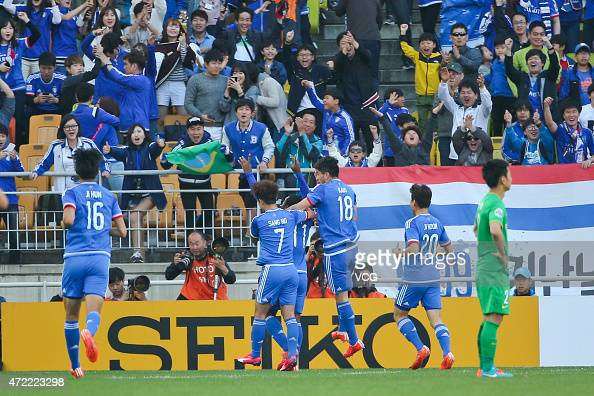 Leo Itaperuna of Suwon Samsung FC celebrates with team mates after scoring the equalizer during the AFC Champions League Group G match between Suwon...