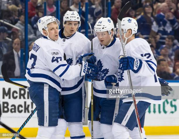 Leo Komarov Alexey Marchenko Morgan Rielly and Connor Brown of the Toronto Maple Leafs celebrate a goal during the second period against the Tampa...