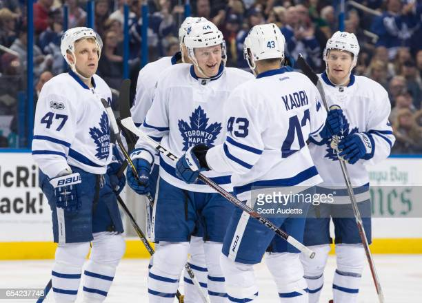 Leo Komarov Alexey Marchenko Morgan Rielly Nazem Kadri and Connor Brown of the Toronto Maple Leafs celebrate a goal during the second period against...
