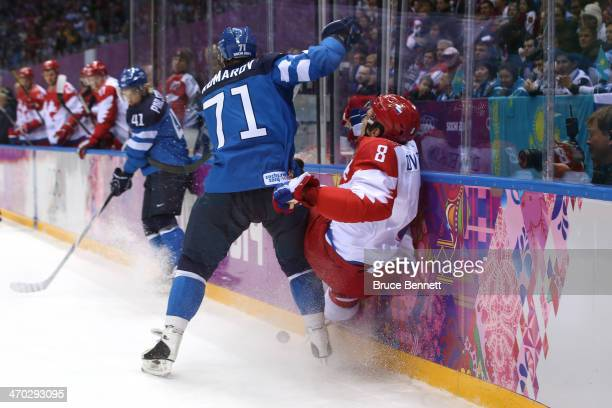 Leo Komarov of Finland checks Alexander Ovechkin of Russia into the boards during the Men's Ice Hockey Quarterfinal Playoff on Day 12 of the 2014...