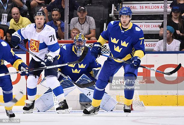 Leo Komarov of Team Finland and Henrik Lundqvist and Victor Hedman of Team Sweden follow the play during the World Cup of Hockey 2016 at Air Canada...