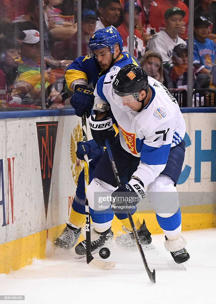 Leo Komarov #71 of Team Finland and Niklas Hjalmarsson #4 of Team Sweden battle for the puck along the boards during the World Cup of Hockey 2016 at Air Canada Centre on September 20, 2016 in Toronto, Ontario, Canada.
