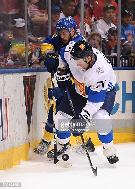 Leo Komarov of Team Finland and Niklas Hjalmarsson of Team Sweden battle for the puck along the boards during the World Cup of Hockey 2016 at Air...
