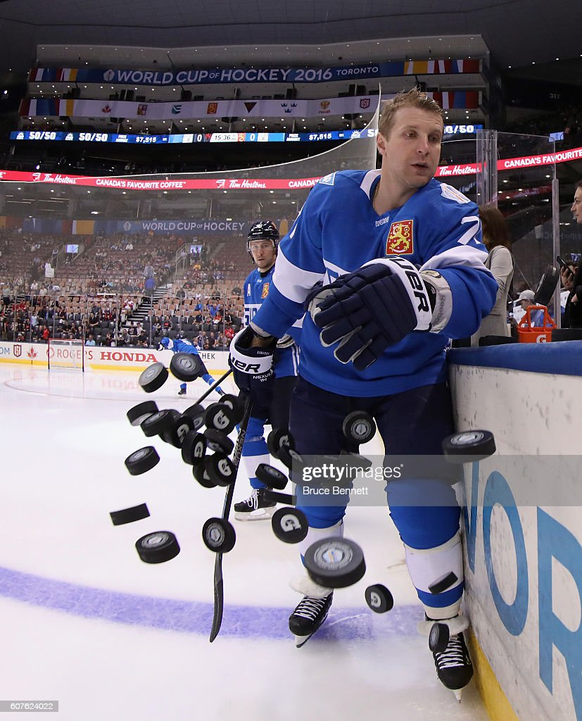 Leo Komarov #71 of Team Finland hits the practice pucks on to the ice prior to his game against Team North America at the Air Canada Centre on September 18, 2016 in Toronto, Canada.
