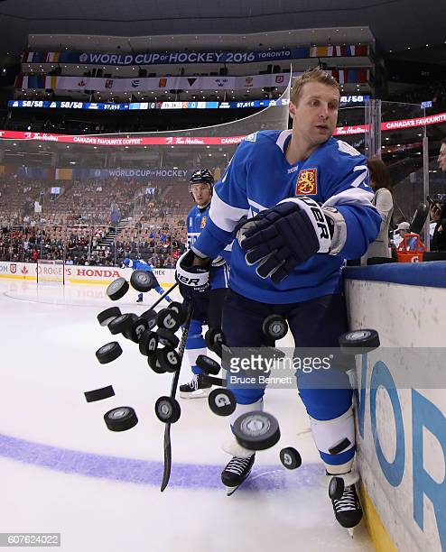 Leo Komarov of Team Finland hits the practice pucks on to the ice prior to his game against Team North America at the Air Canada Centre on September...