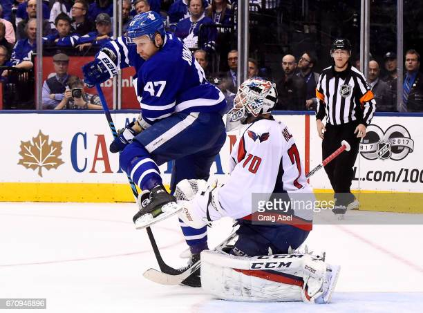 Leo Komarov of the Toronto Maple Leafs attempts to screen Braden Holtby of the Washington Capitals during the first period in Game Four of the...