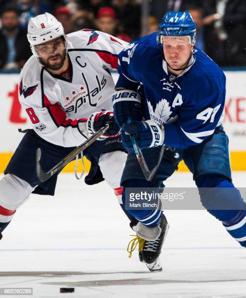 Leo Komarov of the Toronto Maple Leafs battles with Alex Ovechkin of the Washington Capitals during the third period at the Air Canada Centre on...