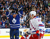 Leo Komarov of the Toronto Maple Leafs celebrates his gamewinning goal against Lee Stempniak of the New York Rangers during NHL action at the Air...